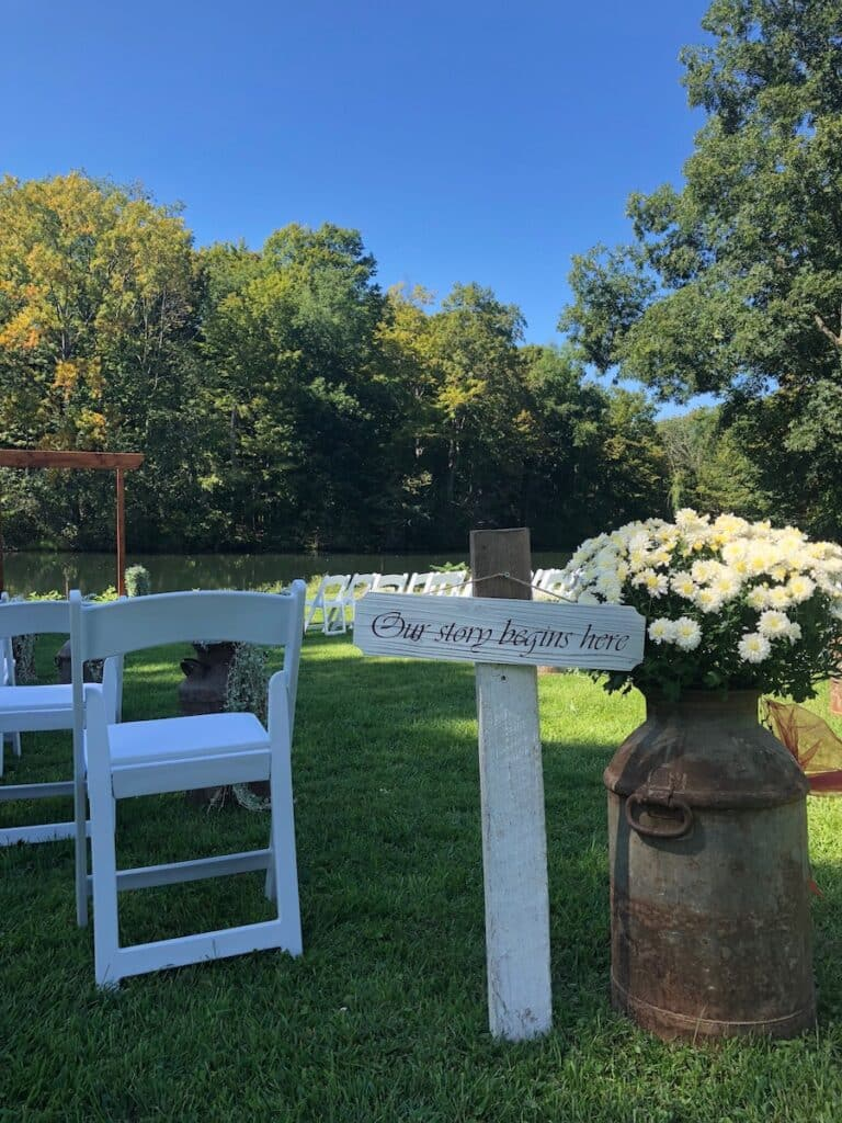 """Sogn thay reads """"Our story begins here"""" at an Adelyn Farm Wedding"""